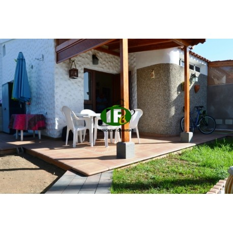 Large bungalow with 2 bedrooms and a large terrace, fenced. Partly tiled and covered