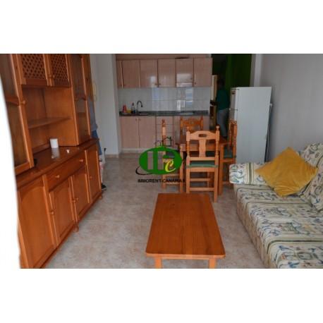 Квартира на 1 этаже с 2 спальнями и балконом.