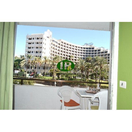 One bedroom apartment on the 3rd floor with a balcony overlooking the communal pool
