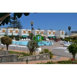 Bungalow de vacaciones con 2 dormitorios y terraza abierta con plaza de aparcamiento privada