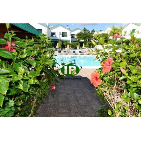 Este bungalow con 1 dormitorio y terraza de azulejos en una zona tranquila cerca del mercado semanal de San Fernando - 1