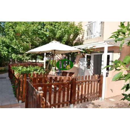 Duplex bungalow with 1 bedroom. Tiled, fenced terras with open side - 1