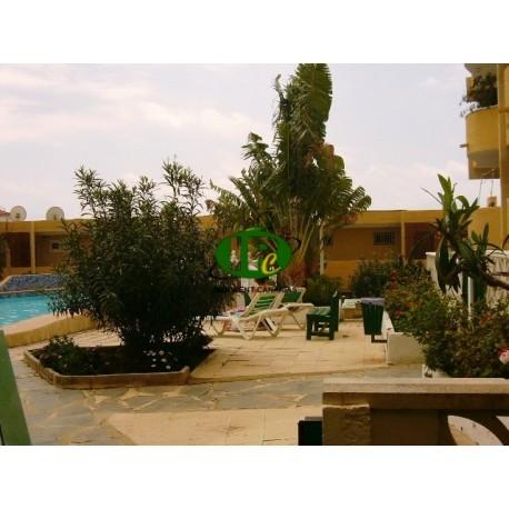 Urlaubsapartment mit 2 Schlafzimmern und 2 Terrassen im Parterre mit Blick auf etwas Grün und den Gemeinschaftspool - 22