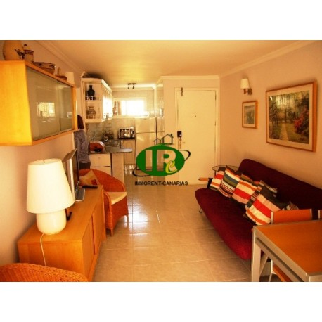 2-bedroom apartment with south-facing balcony on 1st floor. Located in a quiet side street