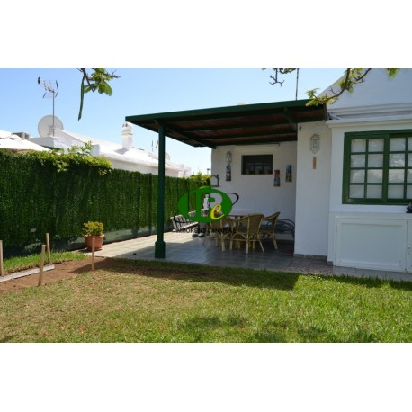 Corner bungalow with 2 bedrooms and large terrace, fenced - 1